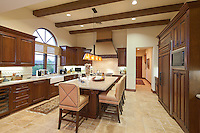 Contemporary kitchen with dining table and chair in luxury villa