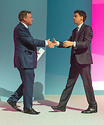 © Licensed to London News Pictures. 22/09/2014. Manchester, UK. Ed Balls shakes hands with Ed Miliband after his keynote speech to the Labour Party Conference 2014 at the Manchester Convention Centre today 22 September 2014. Photo credit : Stephen Simpson/LNP