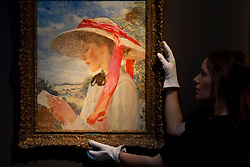 © Licensed to London News Pictures. 08/12/2011. London, UK.Dame Laura Knight's 'A Girl Reading' (est £100,000-150,000) a rare portrait of Florence Carter-Wood, (later Mrs Mannings) (whose tragic life story is to dramatized in a film titled 'Summer in February which will star Downton Abbey actor Dan Stevens) on display at Christie's where it will be auctioned off on 15th December, the auction is expected to realise in excess of £4.5million.  Photo credit : James Gourley/LNP