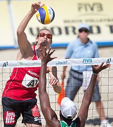 30.07.2014, Strandbad, Klagenfurt, AUT, FIVT, A1 Beachvolleyball Grand Slam 2014, Hauptrunde, im Bild Daniel Müllner (AUT) gegen Evandro Goncalves Oliveira (BRA) // during Main Draw Match of the A1 Beachvolleyball Grand Slam at the Strandbad Klagenfurt, Austria on 2014/07/30. EXPA Pictures © 2014, EXPA Pictures © 2014, PhotoCredit: EXPA/ Johann Groder