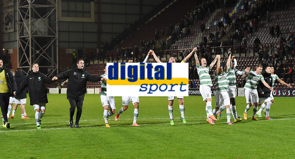 30/11/14 WILLIAM HILL SCOTTISH CUP 4TH RND<br /> HEARTS v CELTIC <br /> TYNECASTLE<br /> The Celtic squad celebrate with manager Ronny Deila and their fans at the full time whistle