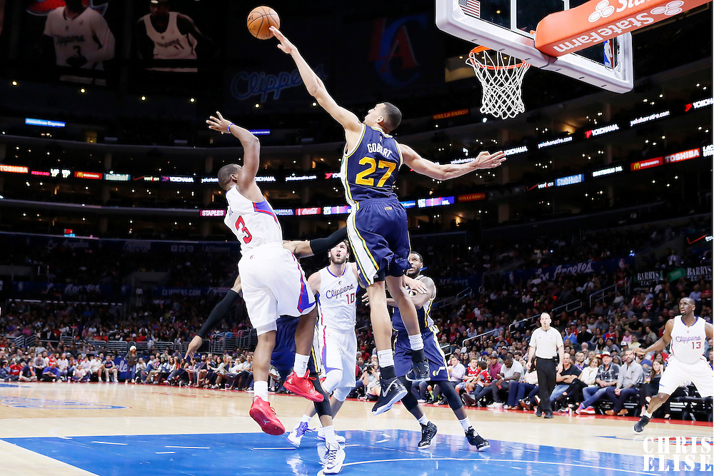17 October 2014: Utah Jazz center Rudy Gobert (27) blocks Los Angeles Clippers guard Chris Paul (3) during the Los Angeles Clippers 101-97 victory over the Utah Jazz, in a preseason game, at the Staples Center, Los Angeles, California, USA.