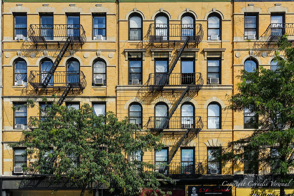 Facade with fire escapes of Columus Avenue between 83rd and 84th street