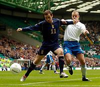 Photo: Jed Wee.<br />Scotland v Faroe Islands. European Championships 2008 Qualifying. 02/09/2006.<br /><br />Scotland's James McFadden (L) holds off Faroe Islands' Janus Joensen.