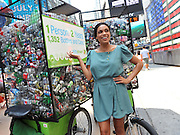 "Actress and environmentalist Rosario Dawson joins SodaStream to kick-off the inaugural ""Unbottle the World Day,"" Monday, July 16, 2012, in New York's Times Square, to combat the environmental hazard of bottle and can waste.  SodaStream, the world's largest manufacturer of home beverage carbonation systems, enables consumers to reduce their own carbon footprint by making carbonated beverages at home.  (Photo by Diane Bondareff/Invision for SodaStream /AP Images)"