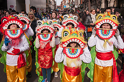 © Licensed to London News Pictures. 22/02/2015. Chinatown, London, UK. Children dressed as lions at the annual Chinese New Year Parade which takes place around Chinatown to celebrate the Year of the Sheep. Photo credit : Stephen Chung/LNP