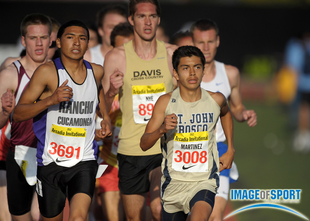 Apr 7, 2012; Arcadia, CA, USA; Danny Martinez of St. John Bosco (right) and Luis Gutierrez of Rancho Cucamonga lead the mile in the Arcadia Invitational at Arcadia High.