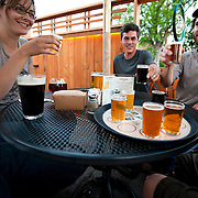 group with sample trey on Bend Brewing Company patio