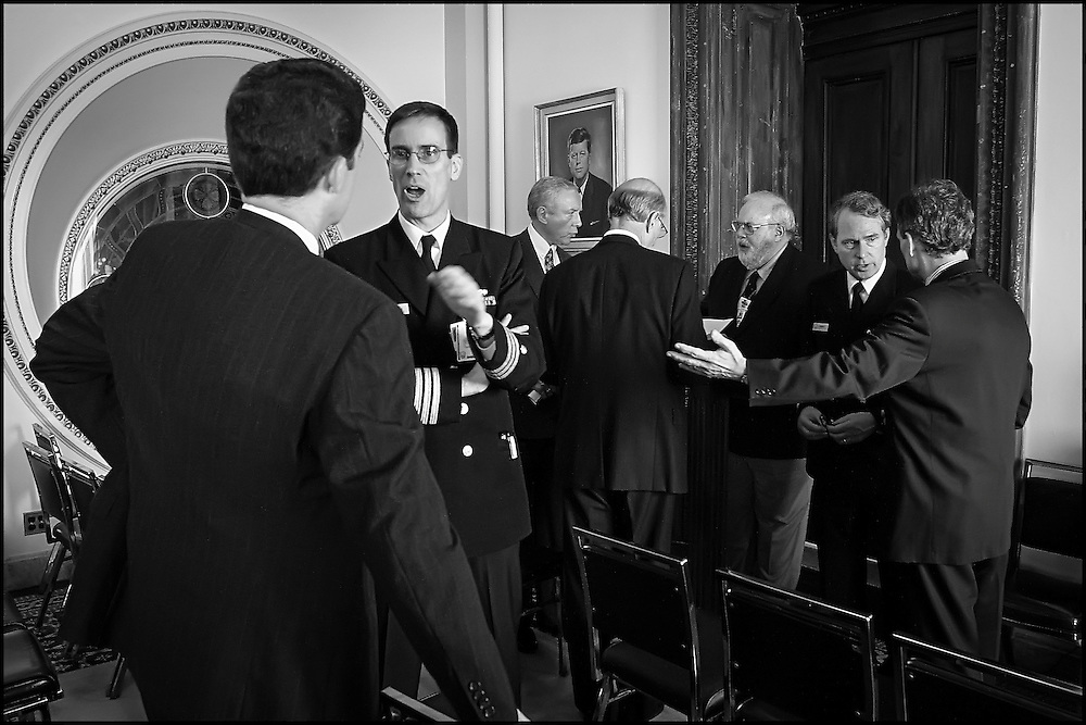 Greg Martin, Doctor of Infecteous Diseses at Bethesda Naval Hospital answers questions from Sen. Brownback after a meeting in Senator Daschle's office concerning the reopening of the Hart Building. ..Sen. Orin Hatch talks  Incident Commander David Stutz as Sen. Pat Roberts looks over the floor plan of the Hart Building...Sen. Daschle confers with Attending Physican for the Capitol Dr. John Eisold.  10/24/01.  .©PF BENTLEY/PFPIX.com