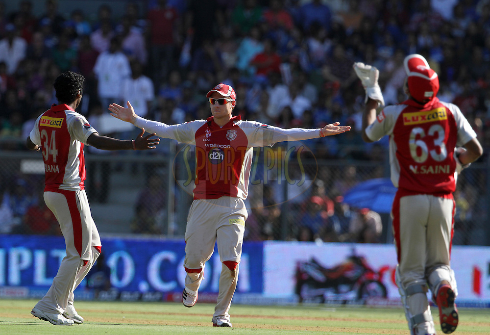 Kings XI Punjab players celebrates after a wicket during match 28 of the Indian Premier League ( IPL) 2012  between The Mumbai Indians and the Kings X1 Punjab held at the Wankhede Stadium in Mumbai on the 22nd April 2012..Photo by: Vipin Pawar/IPL/SPORTZPICS