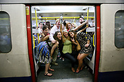 Revellers drinking, Last Round On The Underground Party, Circle Line, London Tube 31/05/2008