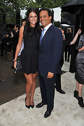 ARUN NAYAR and KIM JOHNSON at the annual Serpentine Gallery Summer Party sponsored by Burberry held at the Serpentine Gallery, Kensington Gardens, London on 28th June 2011.