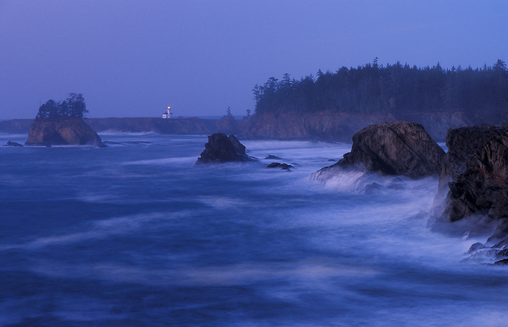 Cape Arago Lighthouse at dusk, from Sunset Bay State Park, Oregon coast.