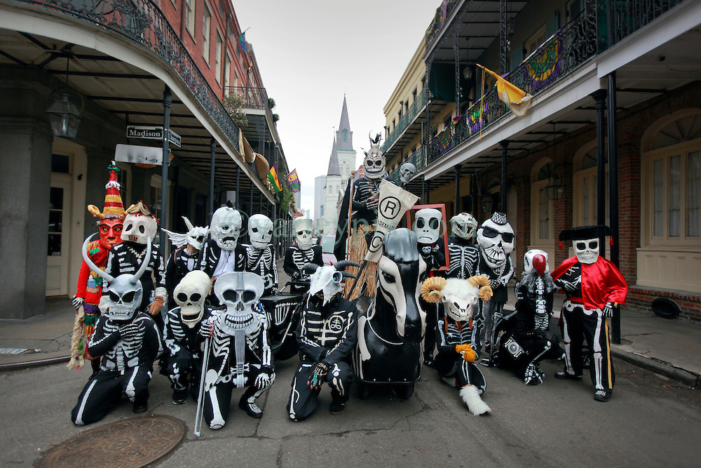 17 Feb 2015. New Orleans, Louisiana.<br /> Mardi Gras Day. Walking with Skeletons. <br /> The Skeleton Krewe poses for a portrait with St Louis Cathedral in the background. The Skeleton Krewe meets before dawn beside a cemetery in Uptown New Orleans. They then walk several miles Along Saint Charles Avenue to the French Quarter to celebrate Mardi Gras Day.<br /> Photo; Charlie Varley/varleypix.com