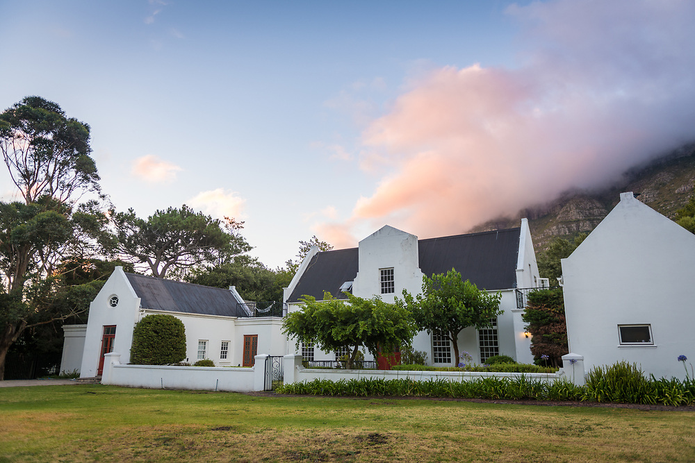 Villa-residence nestled in the foothills of Table Mountain as clouds float above, Cape Town, South Africa