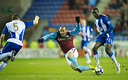 WIGAN, ENGLAND - Tuesday, March 16, 2010: Aston Villa's Gabriel Agbonlahor and Wigan Athletic's Mohamed Diame during the Premiership match at the DW Stadium. (Photo by David Rawcliffe/Propaganda)