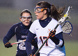 Virginia Cavaliers M Brittany Kalkstein (17) in action against Georgetown Hoyas Megan Ellis (28).  The Virginia Cavaliers Women's Lacrosse team hosted the Georgetown Hoyas at Klockner Stadium in Charlottesville, VA on April 11, 2007.  UVA lead GU 7-3 with 2:45 remaining in the first half.