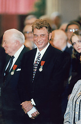File photo : French singer Johnny hallyday is awarded of the medal of 'Chevalier de la Legion d'Honneyr' by President Jacques Chirac during a ceremony held at the Elysee in Paris, France on January 27, 1997. France's biggest rock star Johnny Hallyday has died from lung cancer, his wife says. He was 74. The singer - real name Jean-Philippe Smet - sold about 100 million records and starred in a number of films. Photo by Patrick Durand/ABACAPRESS.COM