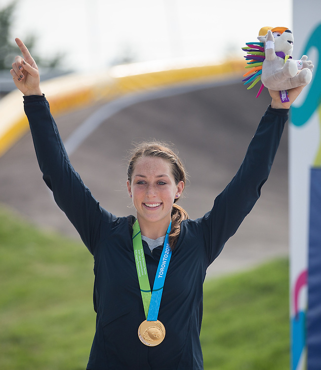 Gold medalist Felicia Stancil of the United States celebrates her win in the BMX at the 2015 Pan American Games in Toronto, Canada July 11,  2015.  AFP PHOTO/GEOFF ROBINS