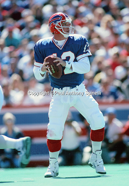Buffalo Bills quarterback Jim Kelly (12) throws a pass during the NFL football game against the Carolina Panthers on Sept. 10, 1995 in Orchard Park, N.Y. The Bills won the game 31-9. (©Paul Anthony Spinelli)