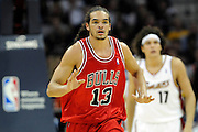 Apr 19, 2010; Cleveland, OH, USA; Chicago Bulls center Joakim Noah (13) makes his way down court during the second period against the Cleveland Cavaliers in game two in the first round of the 2010 NBA playoffs at Quicken Loans Arena. Mandatory Credit: Jason Miller-US PRESSWIRE