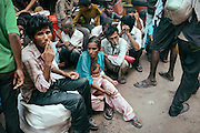 People waiting by a street for free food to be distributed, Chandni Chowk, Old Delhi, India 2013