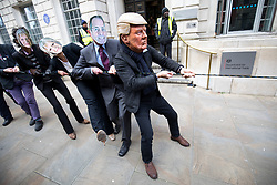 © Licensed to London News Pictures. 06/02/2018. London, UK. Demonstrators take part in a protest  organised by 'War on Want', calling on MPs to demand parliamentary scrutiny of trade deals. The protestors are wearing costumes depicting bankers, judges, Donald Trump, Theresa May and Liam Fox. They are Photo credit : Tom Nicholson/LNP