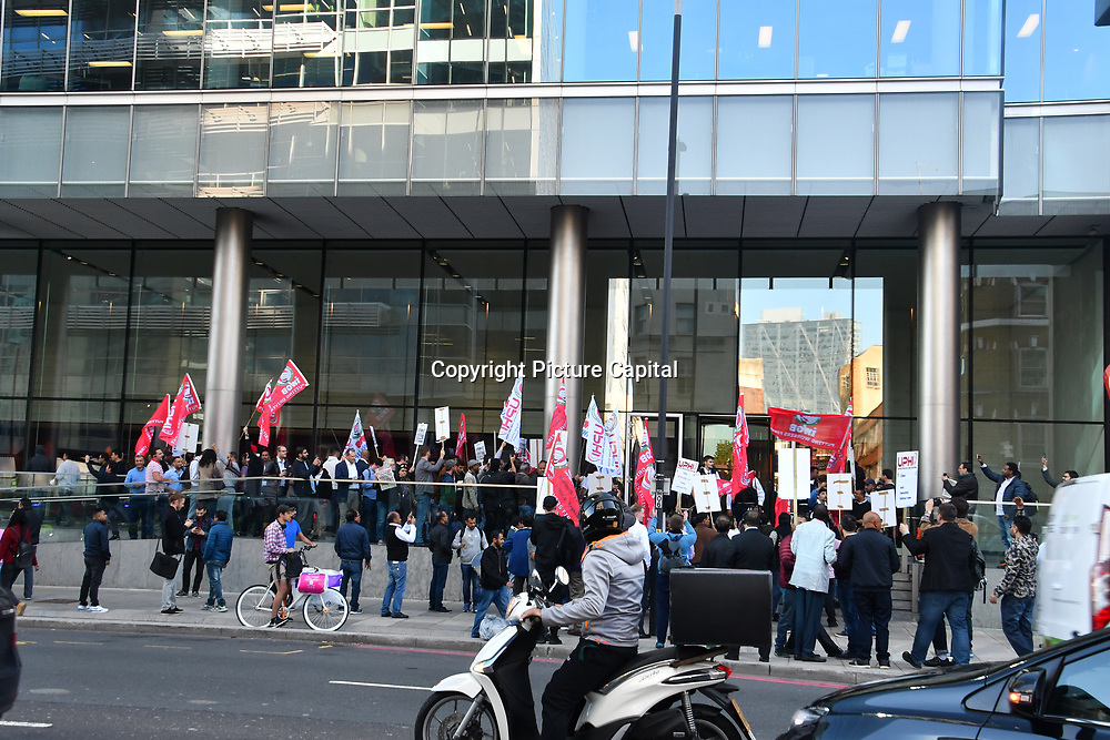Protestors trying to storm in the Uber office demonstration Uber driver strike! demand a minimun wages outside Uber offices, Aldgate Tower, London, UK. 9 October 2018.
