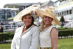 © Licensed to London News Pictures. 08/04/2016. Liverpool, UK. Two glamorous looking ladies pose in their hats on Ladies Day at the Grand National 2016 at Aintree Racecourse near Liverpool. The race, which was first run in 1839, is the most valuable jump race in Europe. Photo credit : Ian Hinchliffe/LNP