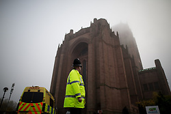 © Licensed to London News Pictures . 02/11/2015 . Liverpool , UK . A police officer outside the cathedral after the service . The funeral of Police Constable Dave Phillips , at Liverpool Cathedral . Five people are charged in connection with his death , including Clayton Williams , 18 , from Wallasey , who is charged with murder . Photo credit: Joel Goodman/LNP