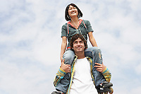 Young Man with Woman on Shoulders
