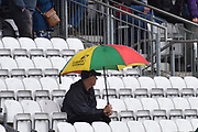Umbrellas goes up in the stands as heavy rain starts to fall ahead of play during the Specsavers County Champ Div 1 match between Somerset County Cricket Club and Essex County Cricket Club at the Cooper Associates County Ground, Taunton, United Kingdom on 26 September 2019.