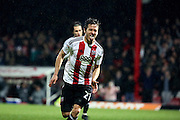 Brentford striker Lasse Vibe (21) scoring his second goal and Brentfords third 3-0 during the EFL Sky Bet Championship match between Brentford and Aston Villa at Griffin Park, London, England on 31 January 2017. Photo by Matthew Redman.