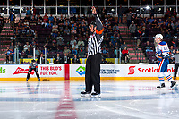 PENTICTON, CANADA - SEPTEMBER 9: Mark Pearce, referee stands at centre ice between the # of Edmonton Oilers and the Winnipeg Jets on September 9, 2017 at the South Okanagan Event Centre in Penticton, British Columbia, Canada.  (Photo by Marissa Baecker/Shoot the Breeze)  *** Local Caption ***