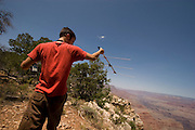 Northern Arizona University graduate assistant Ben Solvesky uses a receiver to pick up a radio signal from a Allen's big-eared bat (Idionycteris phyllotis) that he placed a transmitter on the night before. He wants to find the day-roosting location (usually well hideen during the day) of the bat to better understand how how far they travel while hunting at night.
