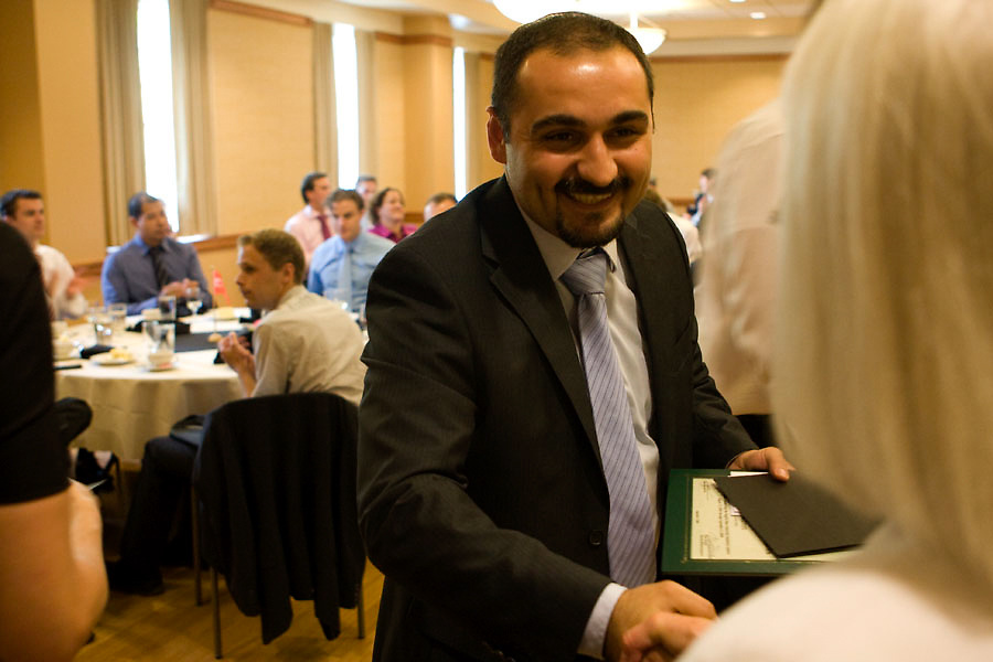 4. Omar Learim, 32, of Sogeti, shakes hands and receives with Muriel Ballou, one of the faculty members of Ohio University without Boundaries program.