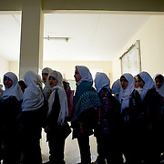 November 11, 2012 - Kabul, Afghanistan: Female students await to orderly leave the school building at Shirino High School in Kabul...After decades without access to education under the Taliban regime, and despite the still existent social stigmas, female students make now 40 per cent of the over all students in the country. (Paulo Nunes dos Santos)