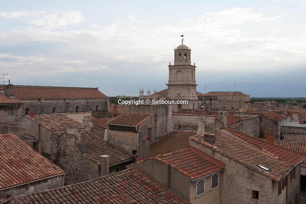 France. Bouches du Rhone.Arles, the belfry of the city hall,  the old city rooftops view from a terrace,   France    /  Arles , le beffroi de la mairie, les toits de la vielle ville vus d une terrace