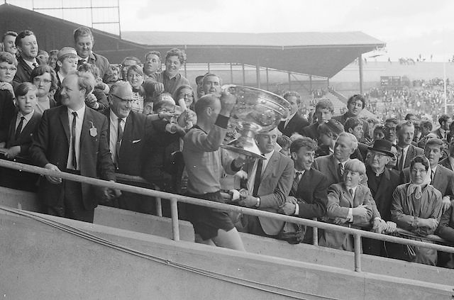 Down Captain Joe Lennon holds the Sam Maguire Cup up to the crowds after the All Ireland Senior Gaelic Football Final Kerry v Down in Croke Park on the 22nd September 1968. Down 2-12 Kerry 1-13.