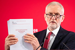© Licensed to London News Pictures. 27/11/2019. London, UK. Leader of the Labour Party Jeremy Corbyn holds up an unreacted copy of a report on trade negotiations with the United States that may affect the NHS at an event in Westminster. Photo credit: Rob Pinney/LNP