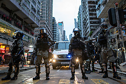 Hong Kong. 6 October 2019. Tens of thousands of pro-democracy protestors march in pouring rain through centre of Hong Kong today from Causeway Bay to Central. Peaceful march later turned violent as a hard-core of protestors confronted police. Pic; Riot police on streets Causeway Bay. Iain Masterton/Alamy Live News.