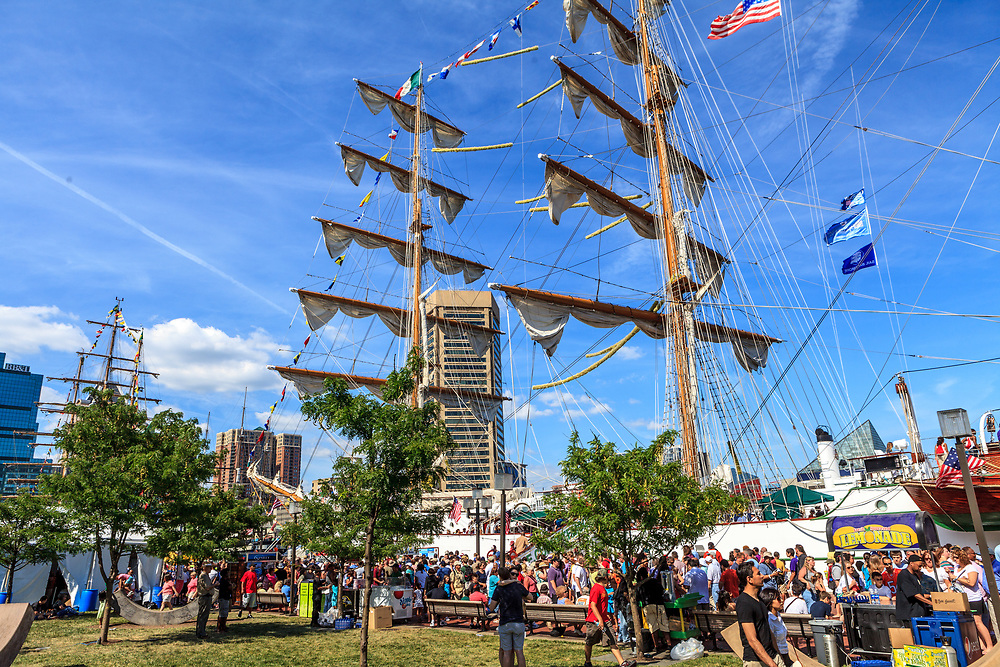 Baltimore, MD, USA - June 16, 2012: Visitors at a large ship on a summer day in the Inner Harbor of the City of Baltimore, Maryland.