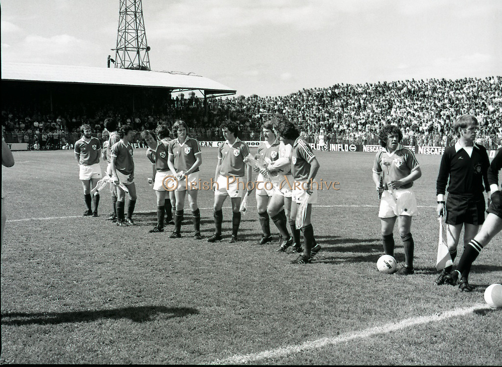 League of Ireland vs Liverpool FC.    (M87)..1979..18.08.1979..08.18.1979..18th August !979..In a pre season friendly the League of Ireland took on Liverpool FC at Dalymount Park Phibsborough,Dublin. The league team was made up of a selection of players from several League of Ireland clubs and was captained by the legendary John Giles. Liverpool won the game by 2 goals to nil..The scorers were Hansen and McDermott..Picture shows the League Of Ireland team under John Giles lining up before kick off.