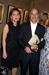 Left to right, City figure LUQMAN ARNOLD and his wife CHUMSRI at a private view of fashion designer Lindka Cierach's Couture Dresses drawn by Trudy Good held at the Belgravia Gallery, 45 Albemarle Street, London on 21st September 2005.<br /><br />NON EXCLUSIVE - WORLD RIGHTS