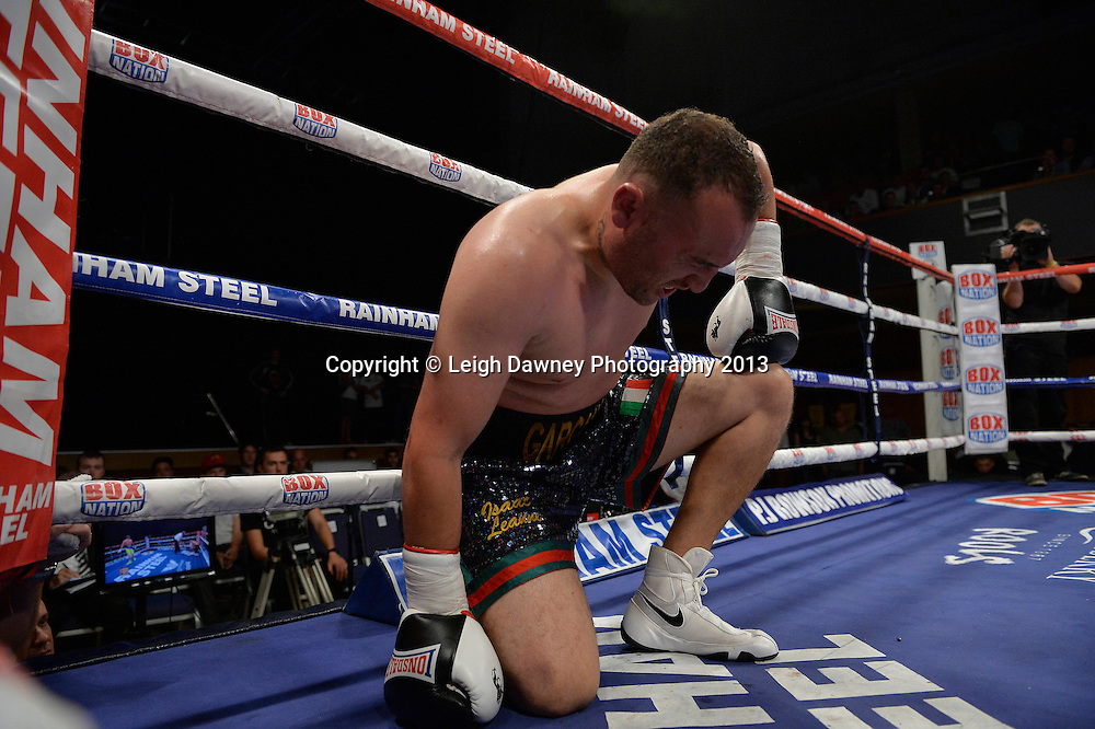 Ricky Summers defeats after knocking down Curtis Gargano in a Light Heavyweight contest at Wolverhampton Civic Hall, Wolverhampton, 1st August 2014. Frank Warren in association with PJ Promotions.  © Credit: Leigh Dawney Photography.