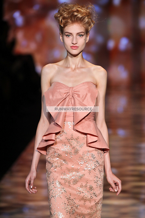 Simona Andrejic walks the runway wearing Badgley Mischka Spring 2012 Collection during Mercedes-Benz Fashion Week in New York on September 13, 2011