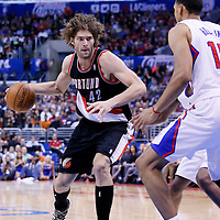 12 February 2014:  Los Angeles Clippers center Ryan Hollins (15) defends on Portland Trail Blazers center Robin Lopez (42) during the Los Angeles Clippers 122-117 victory over the Portland Trail Blazers at the Staples Center, Los Angeles, California, USA.