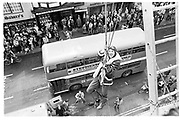 Member of Dangerous sports Club jumping out over Oxford High St. 1983<br />