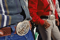 Previous winners show off their buckles from the All-around Championships at the Holbrook fairgrounds in Arizona. From spring through fall there is a rodeo somewhere on the Navajo Nation almost every weekend.  Most of the rodeos are sponsored by one of several Navajo groups. The largest, with about 400 members, is the forty-year-old All Indian Professional Rodeo Cowboy Association.