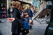 Tourists looking for directions in New York City by 34th Street between 5th And 6th Avenues.